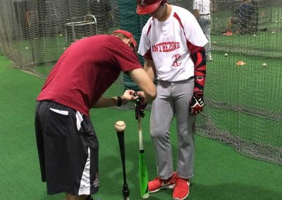 Coach Brandon Horetsky Attaching Diamond Kinetics Sensor To Robert Moran's Bat