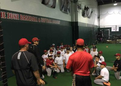 Coaches Address Players, Reviewing Practice Goals